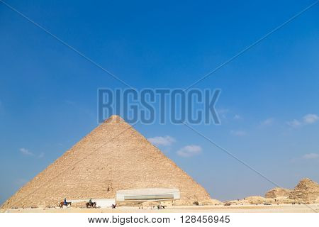 Tourists around The Great Pyramid of Giza, Egypt.