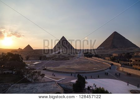 Tourist groups heading to the Sphinx and Great pyramid of Giza, Egypt.
