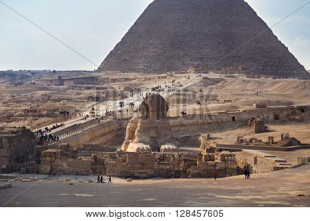 Tourists around the Sphinx and Great pyramid of Giza, Egypt.