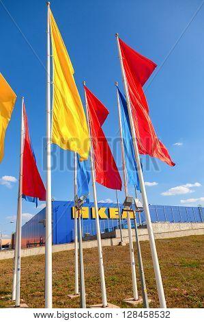 SAMARA RUSSIA - SEPTEMBER 9 2015: IKEA flags against sky at the IKEA Samara Store. IKEA is the world's largest furniture retailer