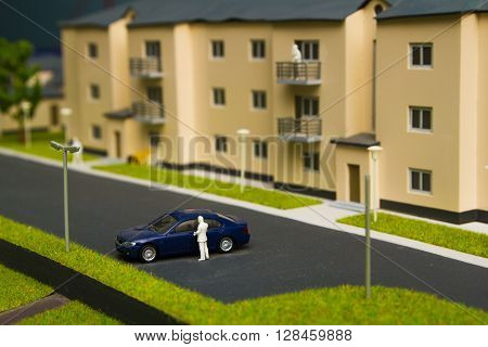 City layout. Part of city with house street little car models