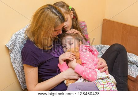 My Mother And Older Sister Comforted A Little Girl Hugging Her To Him And Stroked On The Head