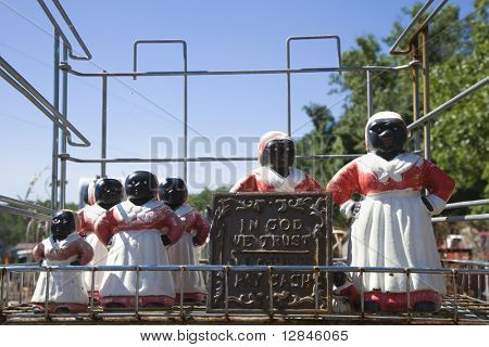 Collection of Aunt Jemima statuettes outdoors.