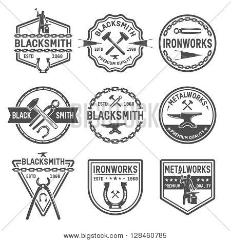 Ironworks black white emblems with working tools blacksmith horseshoe chain and inscriptions isolated vector illustration