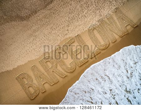 Barcelona written on the beach