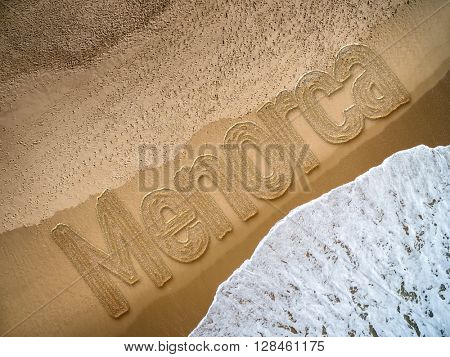 Menorca written on the beach