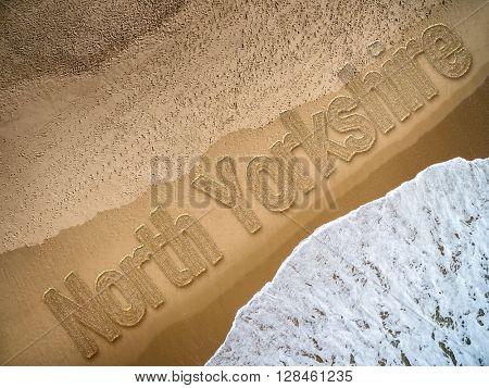 North Yorkshire written on the beach