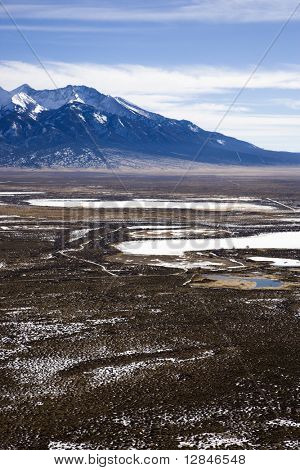 Aerial scenic landscape of mountains and plains in rural Colorado, United States.
