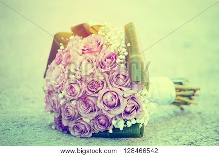 Wedding bouquet of pink roses - retro styled photo