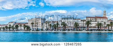 Panorama of town of Split, waterfront view at riva (promenade) and walls of Diocletian Palace, old city center, Croatia.