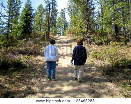 Two woman support going the distance on a treck