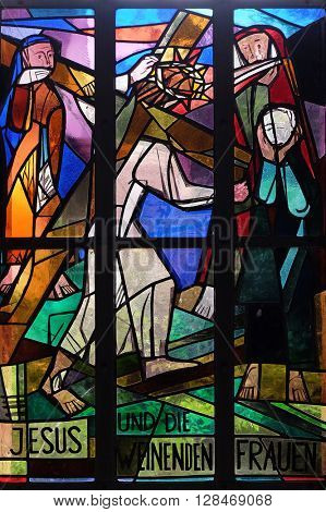 KLEINOSTHEIM, GERMANY - JUNE 08: 8th Stations of the Cross, Jesus meets the daughters of Jerusalem, stained glass window in Saint Lawrence church in Kleinostheim, Germany on June 08, 2015.