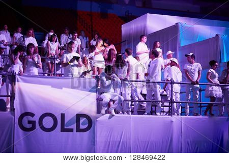 RUSSIA, MOSCOW - JUN 12, 2015: People on Gold premium tiered podium in front of the stage at Sensation Wicked Wonderland show at Olympiysky sports complex.
