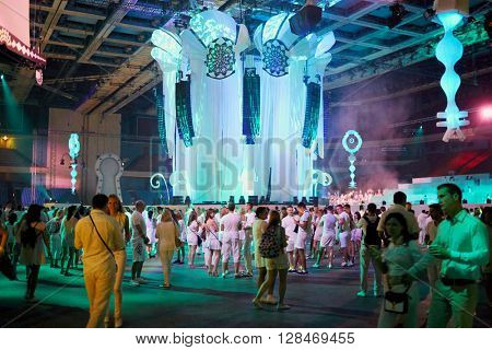 RUSSIA, MOSCOW - JUN 12, 2015: People walk in hall before Sensation Wicked Wonderland show starts at Olympiysky sports complex.