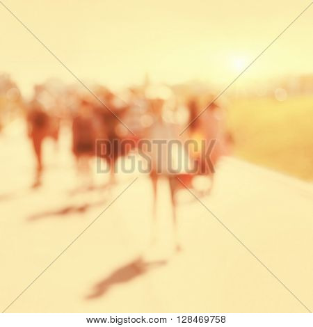 Abstract blurred image of people walking on the street.