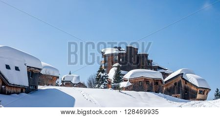 ski resort a lot of snow on roofs of chalets