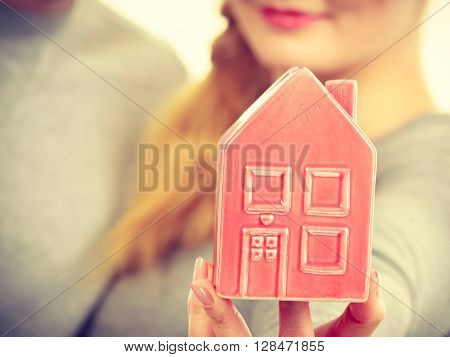 People Together With House Model.