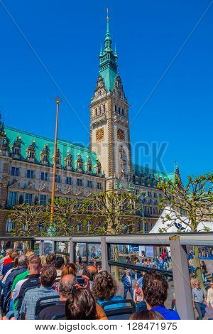 HAMBURG, GERMANY - JUNE 08, 2015: City hall view from a drop on and drop off bus, emblematic buiding. Green roof