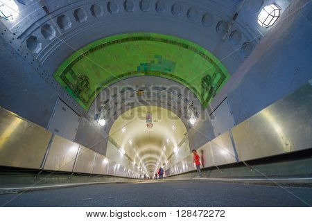 HAMBURG, GERMANY - JUNE 08, 2015: People walking to enter Elbtunnel on Hamburg, pedestrian and car tunnel that goes under water.