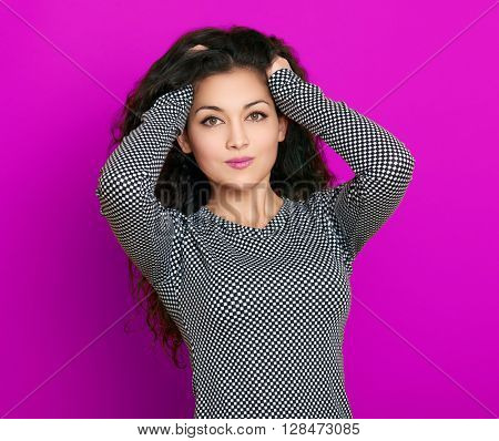 girl glamour portrait on purple background, long curly hair