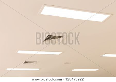 ceiling and fluorescent lighting with exhaust fan louver selective focus