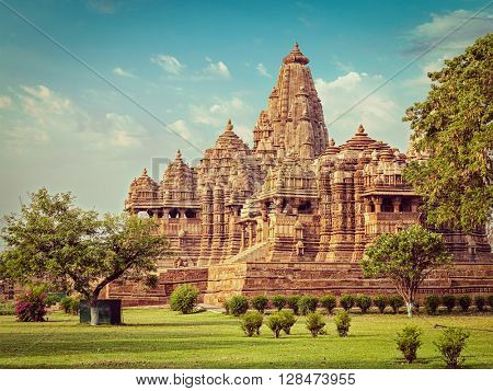 Vintage retro effect filtered hipster style image of famous indian Madhya Pradesh tourist landmark - Kandariya Mahadev Temple, Khajuraho, India. Unesco World Heritage Site