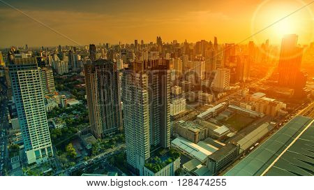 aerial view of sky scraper in heart of bangkok thailand capital with beautiful sun light over sky