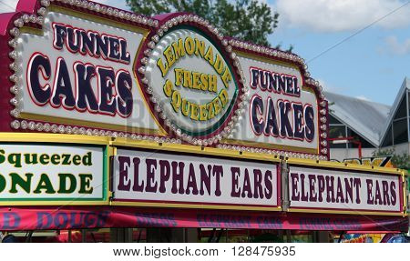 Food Stand Serving Funnel Cakes and Carnival Treats