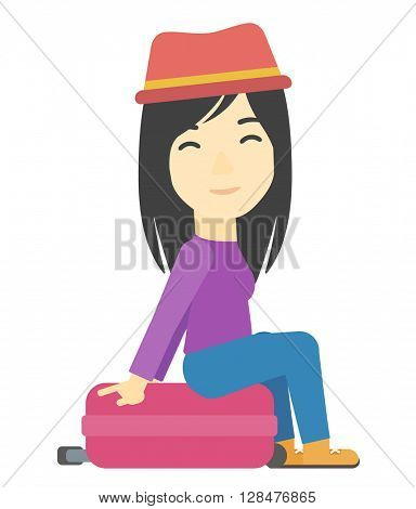 Woman sitting on his suitcase.
