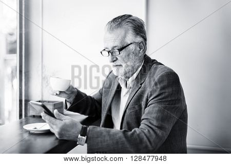 Senior Man Mobile Phone Cafe Coffee Shop Relaxation Concept