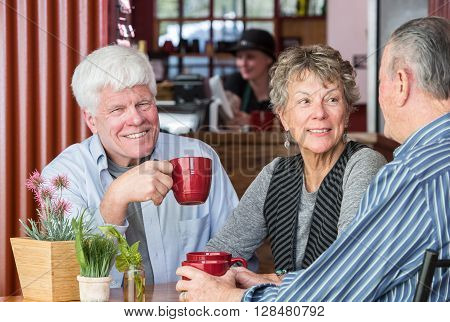 Smiling Man In Coffee House