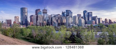 Calgary's skyline with the Bow River and Centre Street Bridge in the foreground.