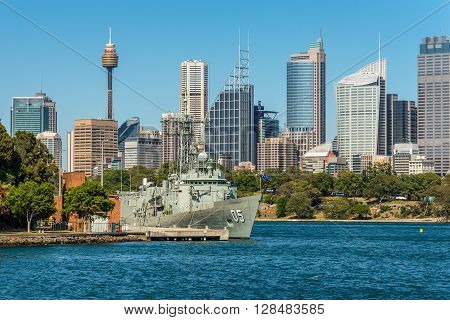 Sydney Australia - November 9 2014: Australian Sydney landmark - city CBD high rises and towers forming megapolis cityscape summer day and the Royal Australian Navy's Frigate Melbourne (III) in the foreground Sydney Australia.