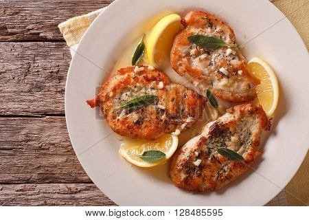 Tasty Chicken Steaks With Sage, Lemon And Garlic Sauce Closeup. Horizontal Top View