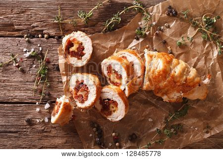 Chicken Roll Stuffed With Cheese And Sun-dried Tomatoes Close-up. Horizontal Top View