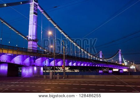 Illuminated Krymsky (Crimean) bridge over Moscow river at night.