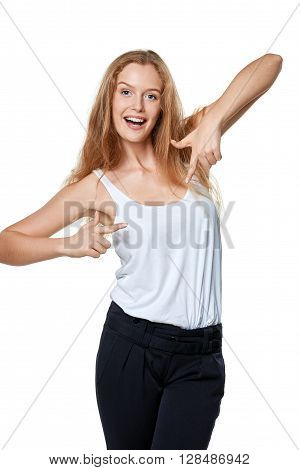 Happy excited woman pointing at herself over white