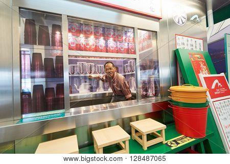 HONG KONG - MARCH 08, 2016: man posing for taking photo in Hong Kong International Airport. Hong Kong International Airport is the main airport in Hong Kong