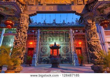 Dusk view of illuminated Hainan Temple UNESCO Heritage Site on March 26 2016 in Georgetown Penang Malaysia.