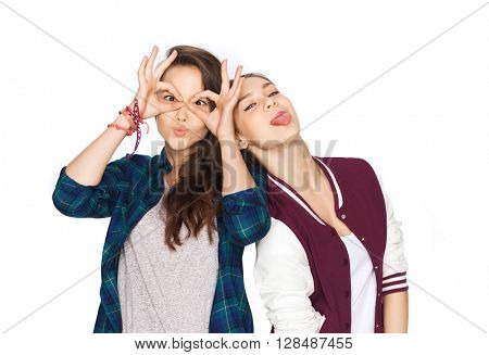 people, friends, teens and friendship concept - happy smiling pretty teenage girls having fun and making faces