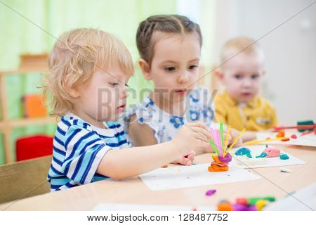 kids doing arts and crafts in kindergarten