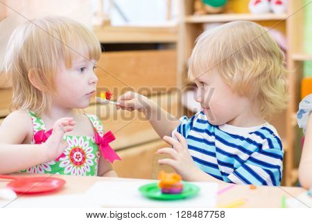 two kids playing in kindergarten together