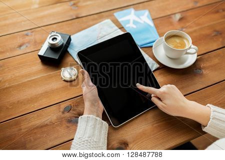 vacation, tourism, travel, technology and people concept - close up of traveler hands with blank tablet pc computer and map