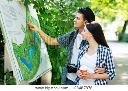 Young couple exploring the park's map.