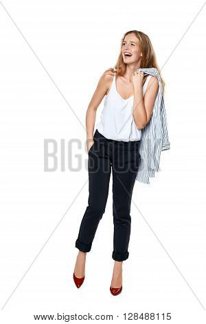 Happy laughing female in full length looking to the side at blank copy space, over white background