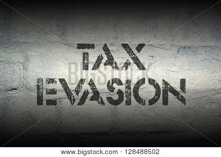 tax evasion stencil print on the grunge white brick wall