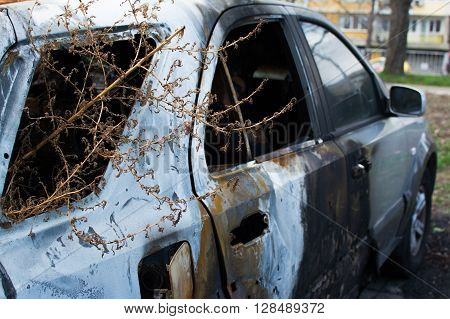An abandoned, stolen burnt out car. Full HD photo.