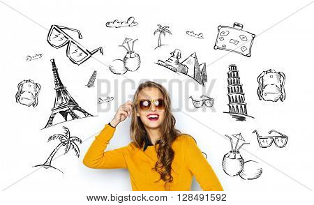people, tourism, vacation and summer holidays concept - happy young woman or teen girl in casual clothes and sunglasses over touristic doodles