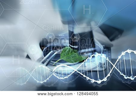 science, chemistry, biology and people concept - close up of scientist hand with microscope and green leaf making research in laboratory over hydrogen chemical formula and dna molecule structure