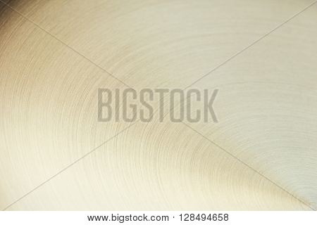 The golden surface with curved lines. The background.